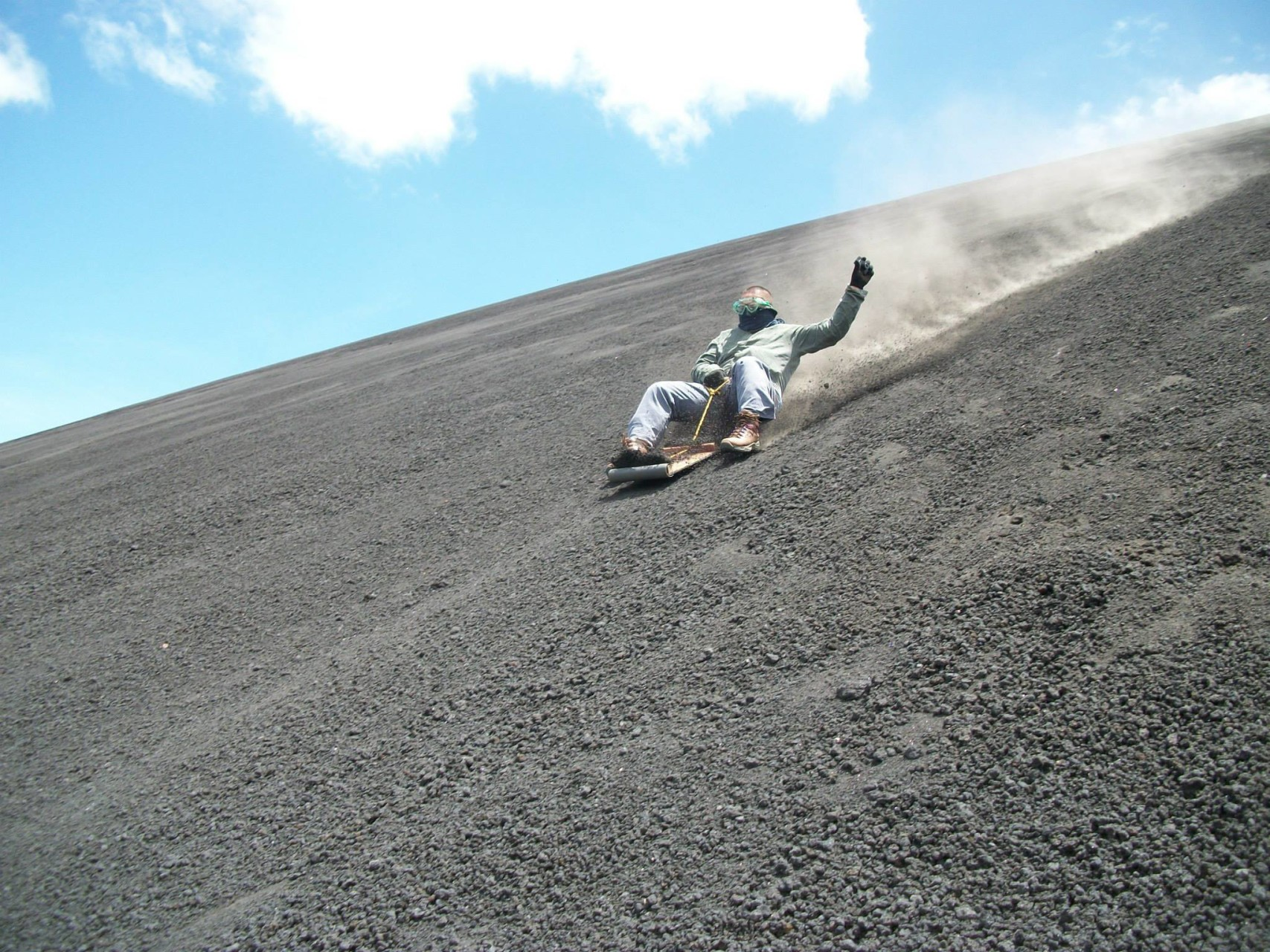 Sand boarding down an active volcano.